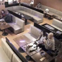 Security footage shows a coronavirus-infected man (right) at a pub in Gamagori, Aichi Prefecture, on March 4. | PUB OPERATOR / VIA KYODO
