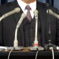 A father of a junior high school student who committed suicide in 2011 attends a news conference in January in Tokyo. | KYODO