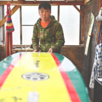 Koji Suzuki, a surfer and a surf shop owner, still has vivid memories of March 11, 2011, when a towering tsunami triggered by a magnitude 9.0 quake surged inland, ravaging the facility. | AFP-JIJI