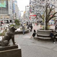 A smattering of people outside the normally bustling Shibuya Station. | KYODO