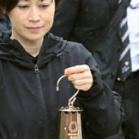 Olympic organizers are set to halt the torch relay amid the coronavirus outbreak and instead use a lantern to carry the flame via car to celebration events. | KYODO