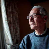 Kazuo Goto, a Tokyo 1964 Olympic Games torch bearer, at his home in Yokosuka, Kanagawa prefecture, on March 16. Goto still vividly remembers his pride as he carried the Olympic flame on the last day of the torch relay in 1964. | AFP-JIJI