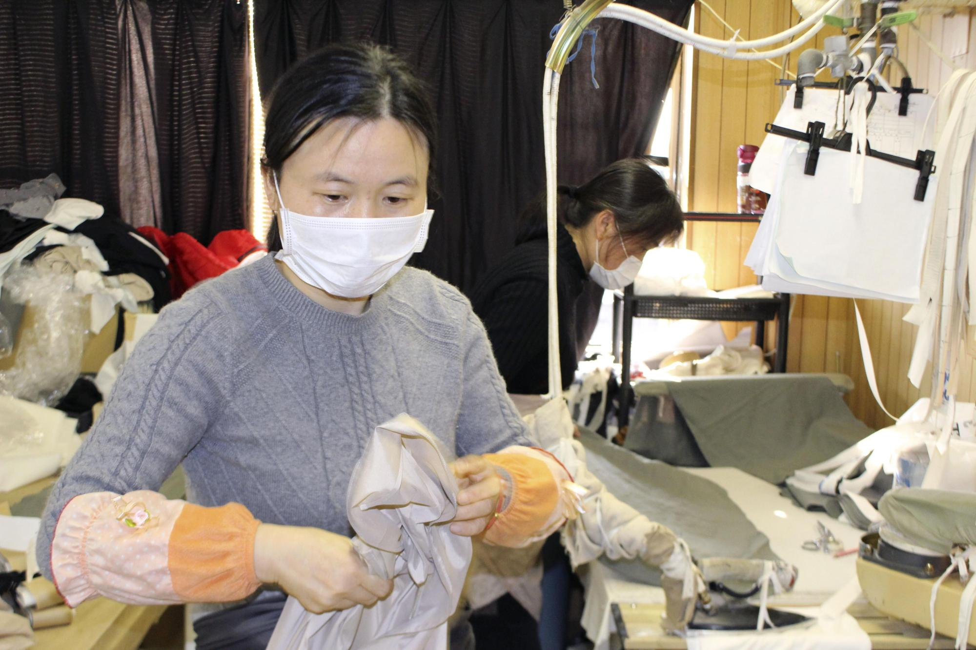A Chinese trainee works at a sewing factory in the city of Gifu on Tuesday. Many Chinese workers haven't been able to start their training programs in Japan due to entry restrictions linked to the new coronavirus, causing a labor shortage in several sectors. | KYODO