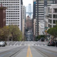 An empty street is shown during rush hour in San Francisco last week. | BLOOMBERG