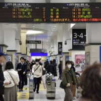 People walk at JR Sannomiya Station in Kobe on Friday, a day after the governors of Osaka and Hyogo requested that nonessential travel between the two prefectures be avoided over the extended weekend. | KYODO