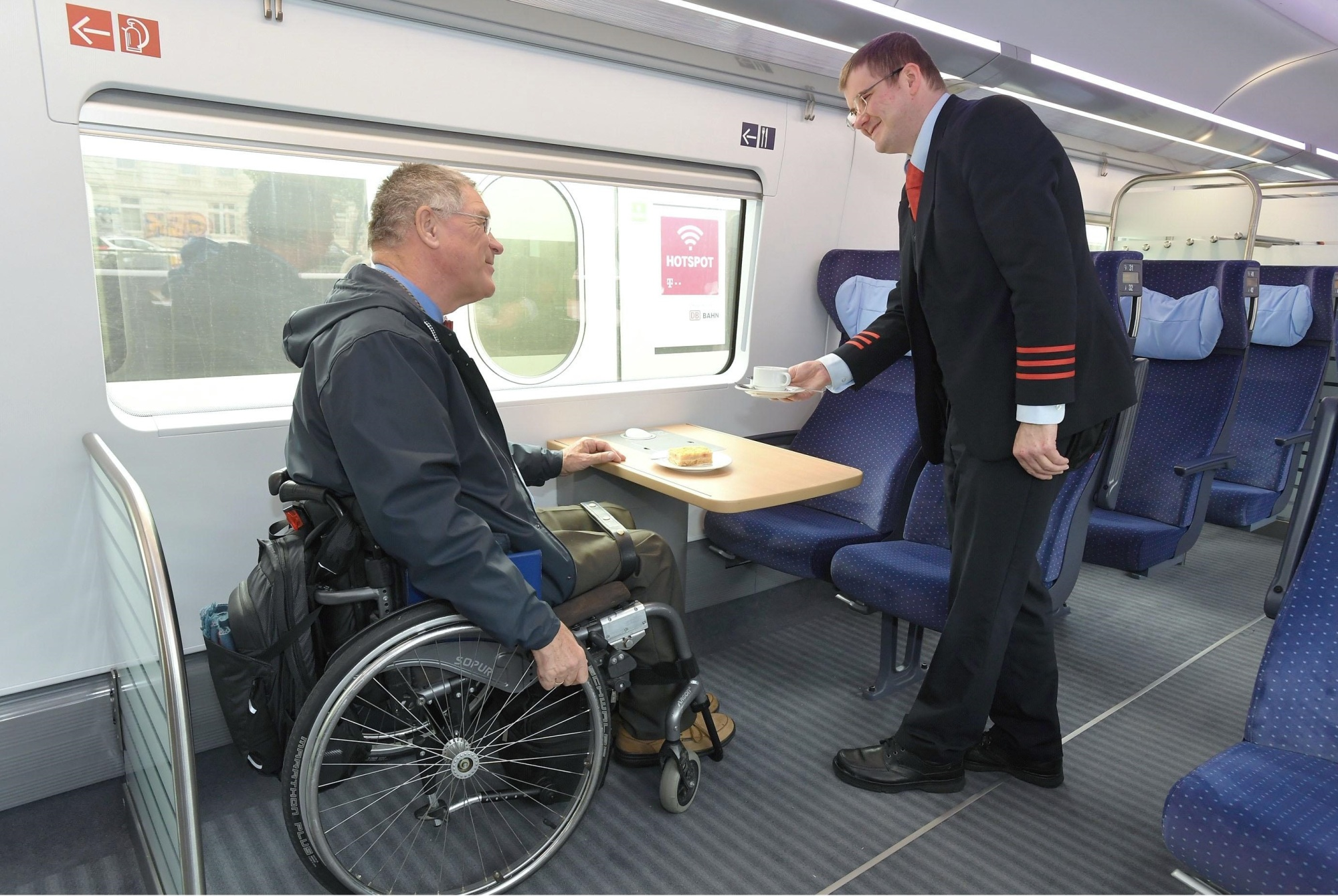 An undated provided photo shows space for wheelchair users inside an express train in Germany. Japan's transport ministry plans to create similar spaces inside shinkansen trains. | KYODO
