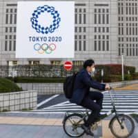 Tokyo Olympics sponsors appear ready to continue supporting the games, but there may be issues ahead regarding sponsorship contracts following a decision to delay the massive sporting event. | BLOOMBERG