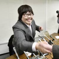 Mika Nishiyama, a former assistant nurse slated to be acquitted of a 2003 murder case on March 31, shakes hands with a supporter in Otsu, Shiga Prefecture, in March 2019.  | KYODO