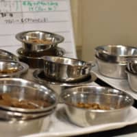 Bowls of pet food are prepared multiple times a day at Wanspace. | KYODO