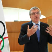 International Olympic Committee President Thomas Bach speaks on Wednesday in Lausanne, Switzerland. | REUTERS
