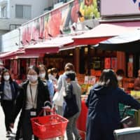 Tokyo shoppers rush out after governor's call to stay in to curb virus