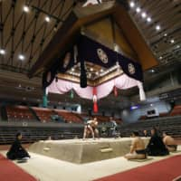 The Spring Basho was held in an empty arena because of the ongoing coronavirus outbreak. | KYODO
