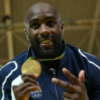 French judoka Teddy Riner poses with his medal after winning gold in the men's over-100-kg division at the Rio Olympics on Aug. 12, 2016, in Rio de Janeiro. | REUTERS