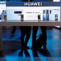 The Huawei logo is displayed on the company's stand during the 'Electronics Show - International Trade Fair for Consumer Electronics' at Ptak Warsaw Expo in Nadarzyn, Poland, in May 2019. | REUTERS