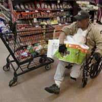 Be prepared: A shopper navigates an isle at Northgate Gonzalez Market in Santa Ana, California, earlier this month. In light of coronavirus concerns, the market opened its stores one hour early for those aged 65 and older, and people with disabilities. | AP