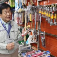 Hidemune Komori, chairman of Kiko, a Tsuruga-based firm which sells industrial machinery and tools for nuclear plants, recalls the time when the city was booming economically because of the Tsuruga plant.  | CHUNICHI SHIMBUN