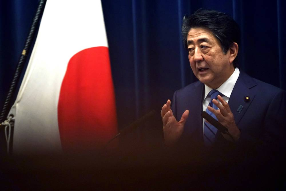 Fending off criticism: Prime Minister Shinzo Abe speaks during a news conference in Tokyo on March 14. | AP