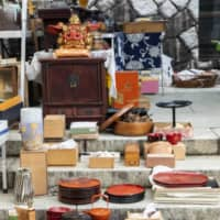 On the steps: Atsuko Kokune, who runs three antique markets including Gozare-ichi, always displays her wares next to the five-storied pagoda at Takahata Fudoson Kongoji temple.