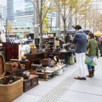 Street fair: The sidewalk lineup at the International Forum market of Korokuten features shops specializing in vintage Japanese furniture.