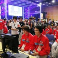 Gamers play Puyo Puyo, a tile-matching video game, at a national esports competition in Ibaraki Prefecture last October. | KYODO