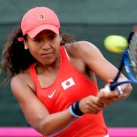 Naomi Osaka hits a return against Sara Sorribes during a Fed Cup match between Japan and Spain on Feb. 7 in Cartagena, Spain. | AFP-JIJI