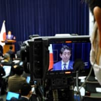 A camera captures Prime Minister Shinzo Abe speaking at a news conference in Tokyo on Saturday.  | AFP-JIJI