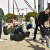 Juliana Nishi (third from left) and her family | KYODO
