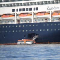 Passengers board a lifeboat from the Zaandam cruise ship, to be transported to sister ship Rotterdam, on Panama Bay, Panama, on Saturday.  | PANAMA MARITIME AUTHORITY / VIA REUTERS