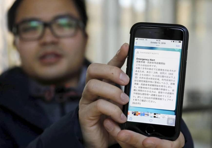 A photo taken last month shows Duong Hong Phong, a Vietnamese man studying in Japan, showing an emergency alert he received when a major typhoon hit eastern Japan in October.   KYODO
