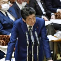 Calls are increasing for Prime Minister Shinzo Abe to declare a state of emergency amid coronavirus crisis. | KYODO