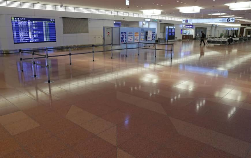 The international arrival lobby of Tokyo's Haneda Airport is mostly empty Monday.   KYODO