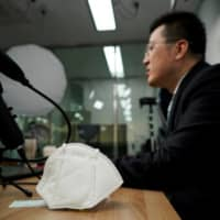 A professor who used to be a coronavirus patient gives an online lecture at Pusan National University in Busan, South Korea. | REUTERS