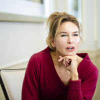 Over the rainbow: Renee Zellweger says being awarded for acting, something she feels lucky to be doing, feels like 'gluttony.' | KYODO / SUPPLIED IMAGE