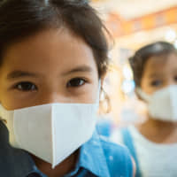 The kids behind the masks: Elementary school students have been asked to stay home in March to prevent the spread of COVID-19. | GETTY IMAGES
