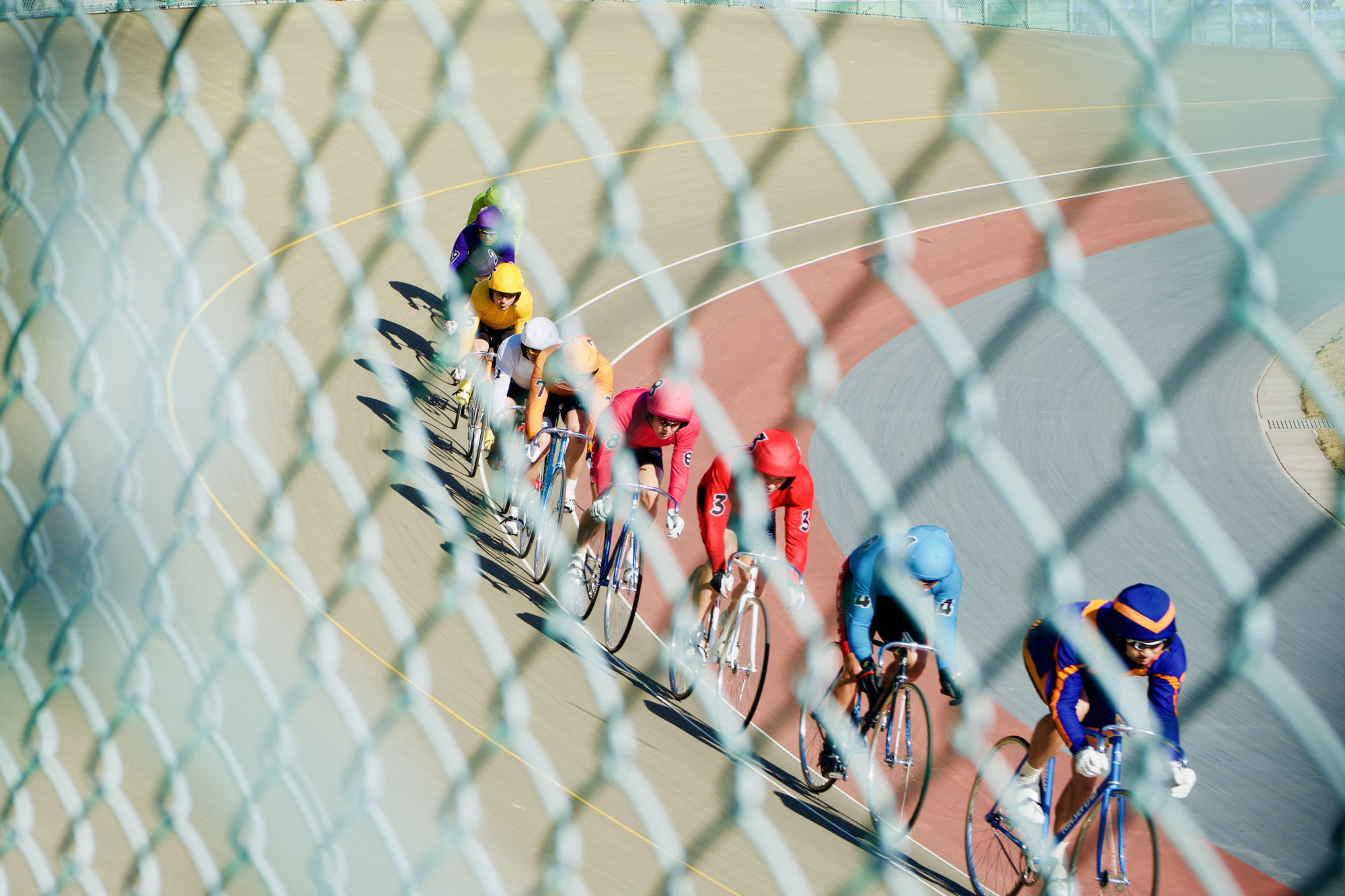 Easing into it: A pacemaker brings the line of keirin racers up to speed. | OSCAR BOYD