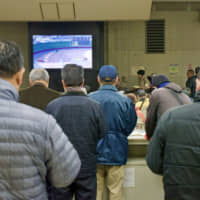 Bet central: The serious action takes place not in the stadium but in the adjacent gambler's hall where punters can watch races from across the country's 43 velodromes.