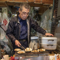 As fresh as it gets: Former fisherman Tamenori Ishimura grills fresh seafood while you wait. He highly recommends the scallops he gets delivered straight from the beach (Maguro no Miyako; Tsukiji 4-13-13).