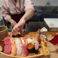 Fresh off the boat: Nigiri sushi is placed in pairs on a boat plate before being served at Hitomi's 'Sushi Chef Experience' lesson. | JASON JENKINS
