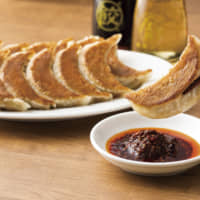 Osakaohsho's gyoza dumplings are stuffed with cabbage, garlic and ginger and come served with the store's secret tare dipping sauce | COURTESY OF OSAKAOHSHO