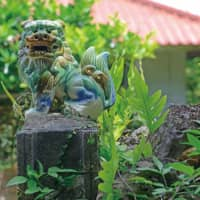 Garden guardians: Lion-dog statues are common features at the entrance to Okinawan homes. | STEPHEN MANSFIELD