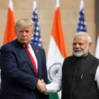 U.S. President Donald Trump and Indian Prime Minister Narendra Modi shake hands at Hyderabad House in New Delhi on Feb. 25, the final day of their bilateral summit.   REUTERS