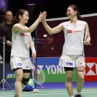 Doubles partners Misaki Matsutomo (left and Ayaka Takahashi celebrate their quarterfinal victory at the All England Badminton Open Championships on Friday in Birmingham, England. | KYODO