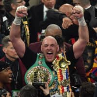 Tyson Fury celebrates after beating Deontay Wilder in the seventh round of their WBC heavyweight championship title fight on Feb. 22 in Las Vegas. The boxers will fight for the third time this summer, according to published reports. | AFP-JIJI