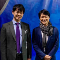 Texas Legends assistant coach Takuma Ito (left) and Hideo Fukushima, the Consul-General of Japan in Houston, pose for a photo in December 2019 in Frisco, Texas.   COURTESY OF ANITA SMITH