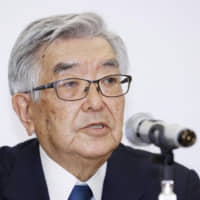 NPB Commissioner Atsushi Saito answers a question during a news conference on Monday. The NPB announced that the start of the regular season will be postponed. | KYODO