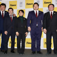 Naohisa Takato (second from the left) and Funa Tonaki (center), 1992 Barcelona Games judo gold medalist Hidehiko Yoshida (far left) and other Park 24 coaches pose for photos at a news conference on Wednesday. | KAZ NAGATSUKA