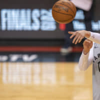 Raptors guard Jeremy Lin makes a pass during media day ahead of the NBA Finals on May 29, 2019, in Toronto. | USA TODAY / VIA REUTERS