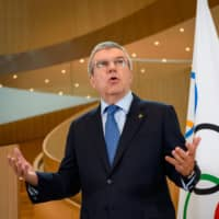 IOC President Thomas Bach delivers a statement on the COVID-19 situation during a meeting of the executive board at the IOC headquarters on March 3 in Lausanne. | AFP-JIJI