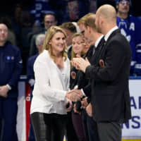 Class of 2019 Hockey Hall of Fame inductee Hayley Wickenheiser shakes hands with hall of famers prior to a game between the Boston Bruins and Toronto Maple Leafs at Scotiabank Arena in Toronto last November. Wickenheiser, an International Olympic Committee member, and reigning Olympic pole vault champion Katerina Stefanidi have blasted plans to press ahead with the Tokyo Games as 'irresponsible' and risky | USA TODAY / VIA REUTERS