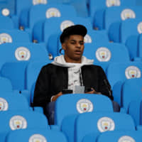 Manchester United's Marcus Rashford sits in the stands before the team's Jan. 29 match against Manchester City at Etihad Stadium. | REUTERS